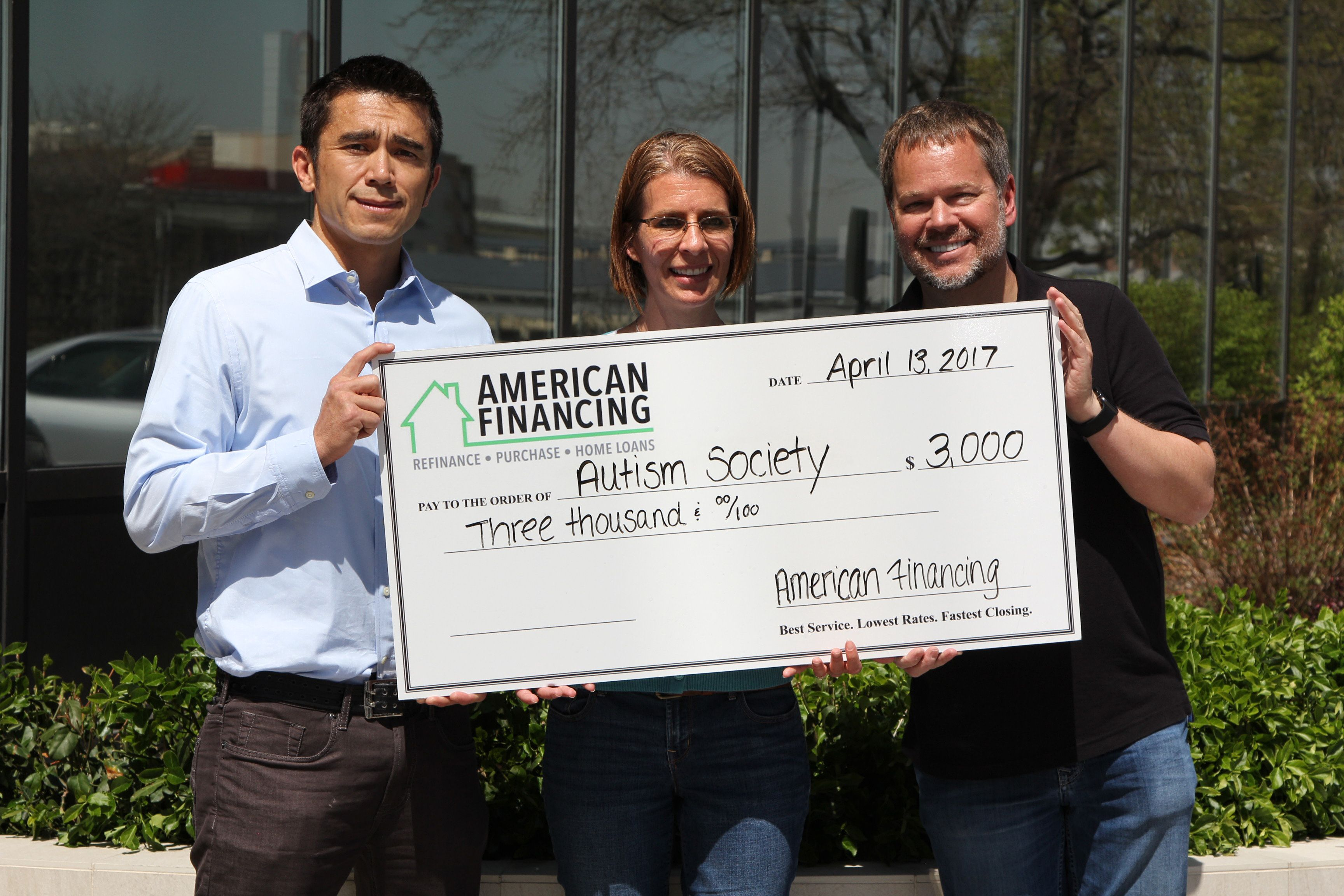 AFC employee donating to the Autism Society of Colorado