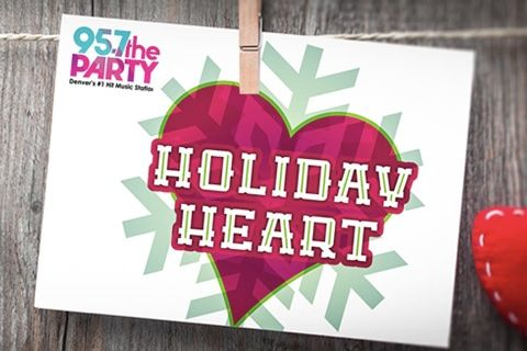 95.7 the Party Holiday Heart charity sign