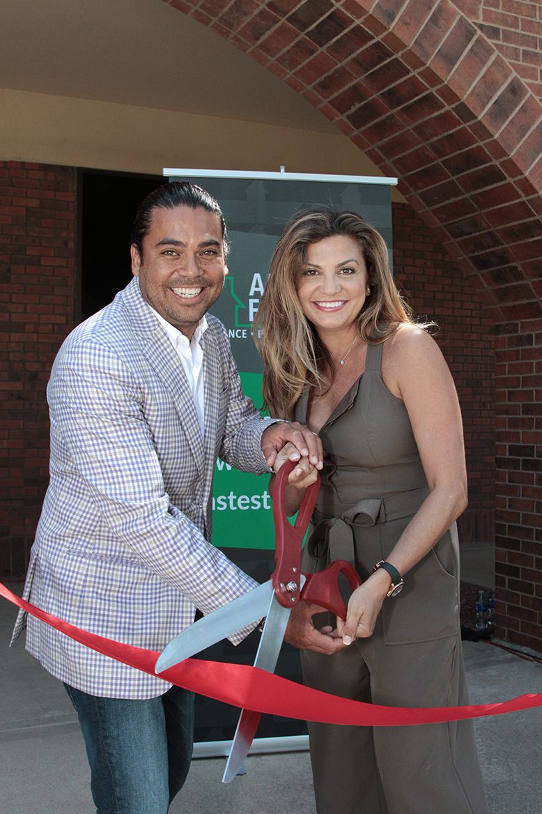 American Financing owners cutting ribbon on new building