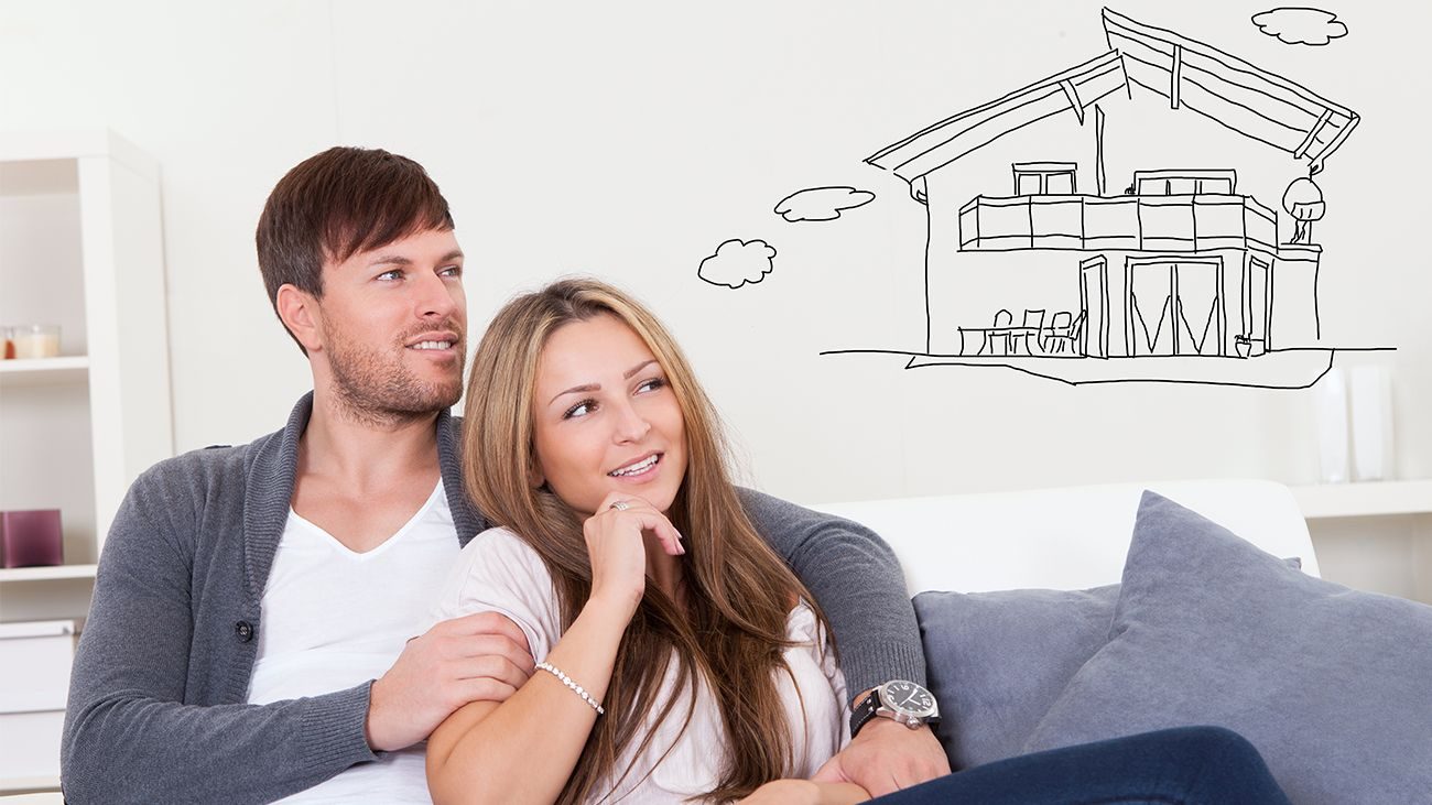 Couple on couch thinking about a home refinance