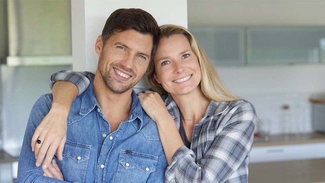 Happy middle-aged couple in kitchen
