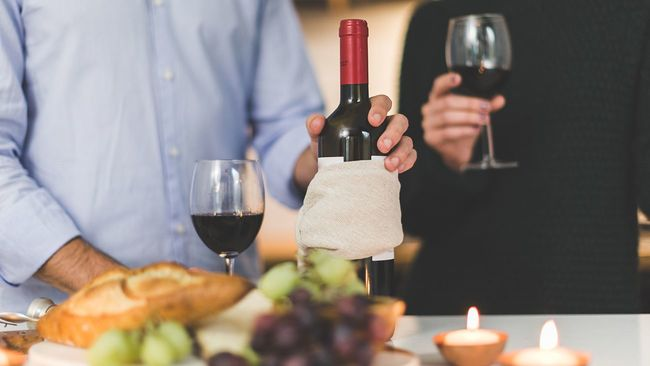 Couple with wine having a date night at home