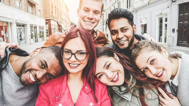 Group of millennial friends smiling