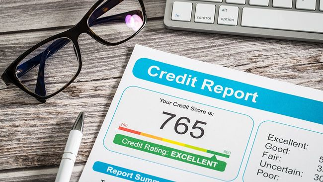 Credit report on desk with 765 score
