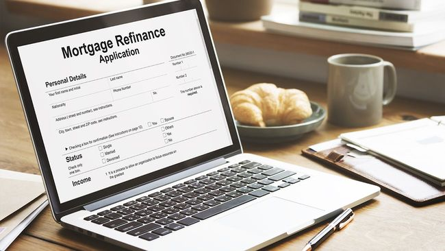 Mortgage refinancing application on laptop screen