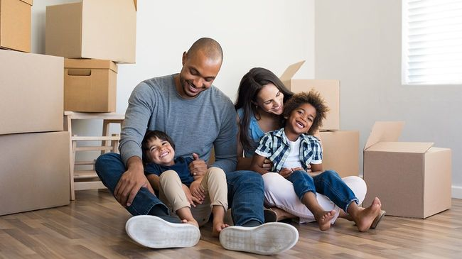 Family with two young children moving into new home.