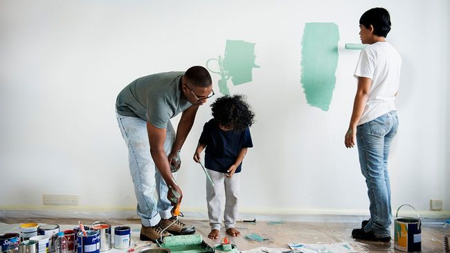 Family painting the interior of their home