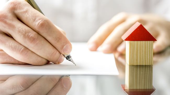 Homeowner signing mortgage documents