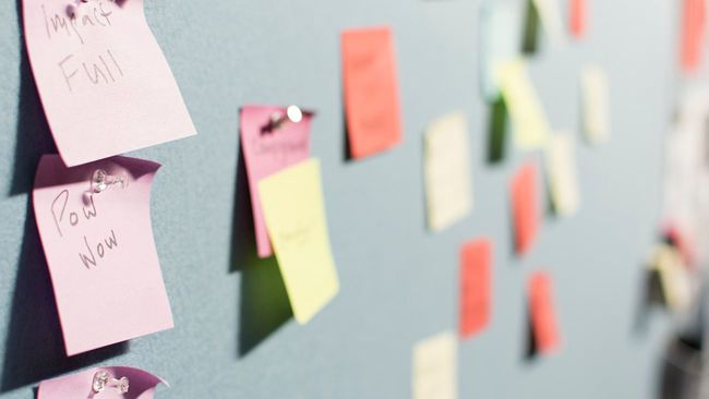 Sticky note reminders on board