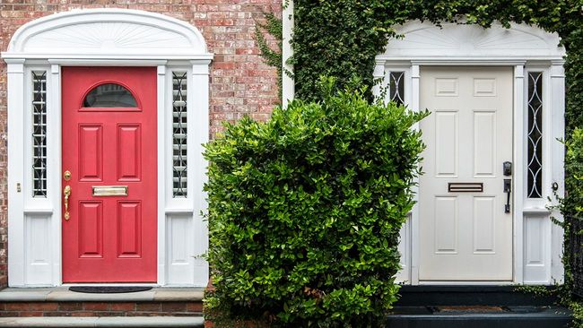 Two side by side entry doors to brick townhomes