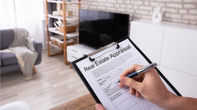 Filling out a home appraisal in living room