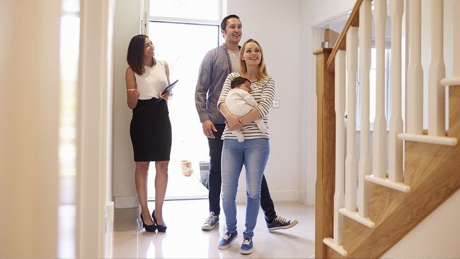 Real estate agent showing young family a new home