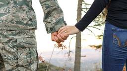 Veteran holding hands with wife