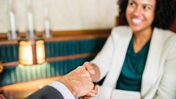 Homebuyer and seller shaking hands.