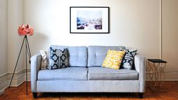 Modern living room with couch wall picture 2x