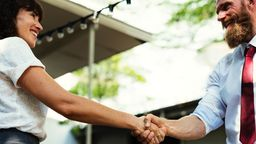 Mortgage lender shaking hands with broker