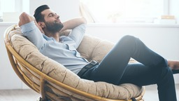 Man relaxing in comfortable chair at home