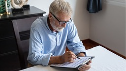 Senior man looking over reverse mortgage application