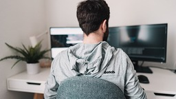 Man working from home on two screens