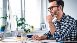 Man focusing on computer in office